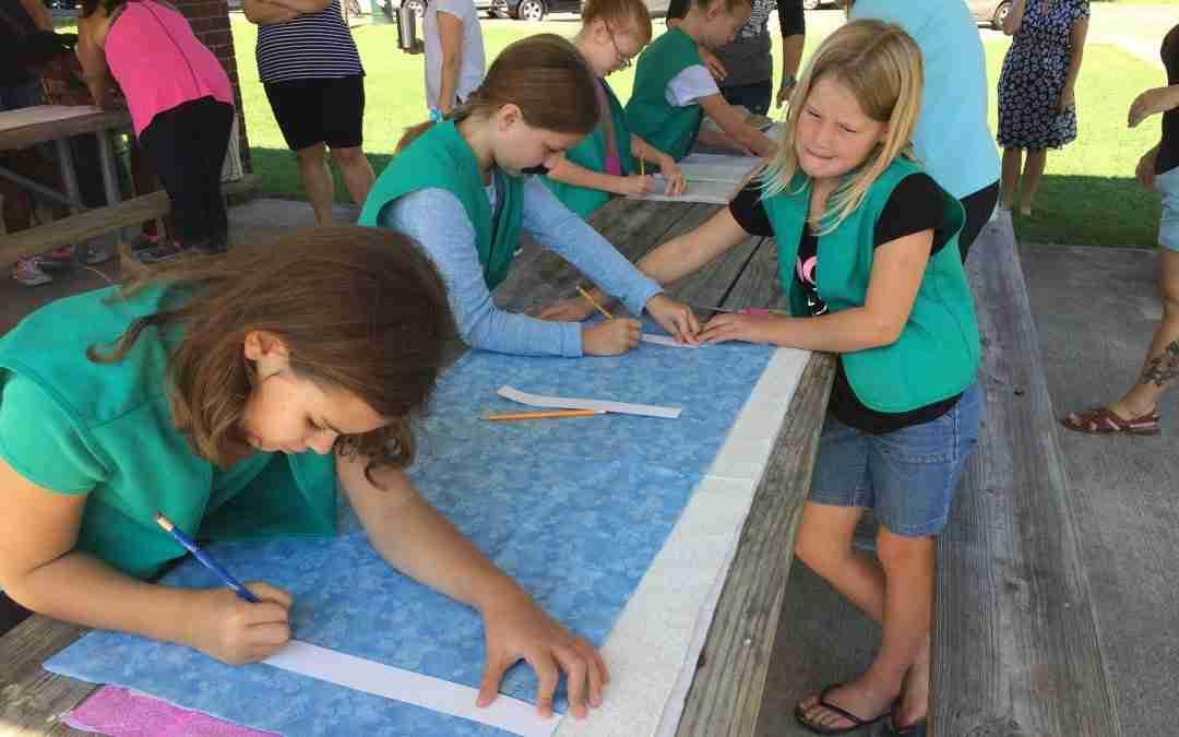 Scouts Help Prep Weaving Project