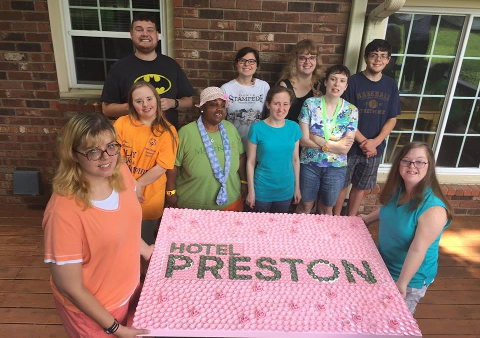 Teapot Diplomats Work on Bottlecap Art Project